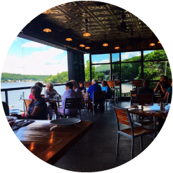 View of the patio seating at Alice's Restaurant overlooking the lake.