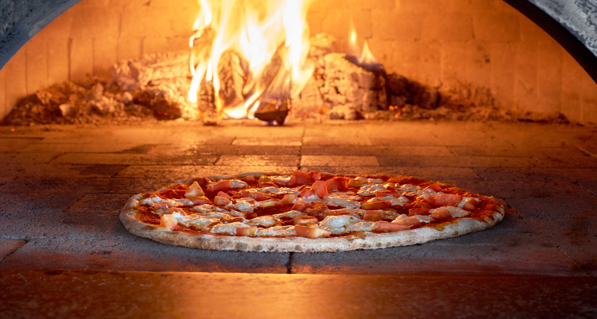 A fresh pizza in the wood burning pizza oven at the Windlass restaurant.