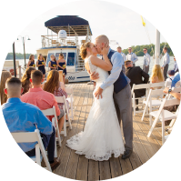 Bride and groom kissing on Miss Lotta water taxi